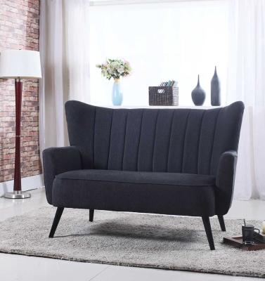 Puter til mørk grå sofa